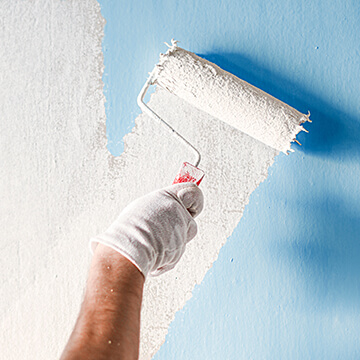 rolling paint on wall
