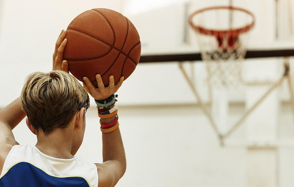 boy shooting baskets